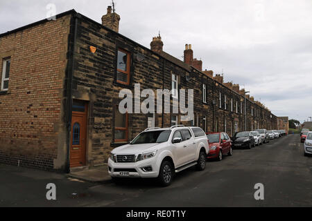 Terraced housing in Amble George Street in Amble.  Amble is a small town on the north east coast of Northumberland in North East England. It was a f - Stock Image