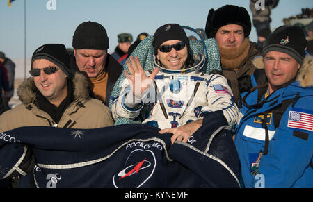 NASA astronaut Randy Bresnik is carried to the medical tent by, Deputy Manager of the International Space Station - Stock Image