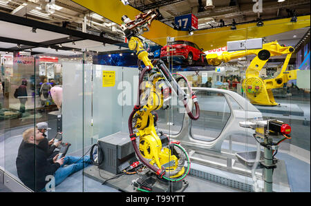 31.03.2019, Hannover, Lower Saxony, Germany - Hanover Fair, industrial robots on the Fanuc booth, here on the press highlight tour the day before the  - Stock Image