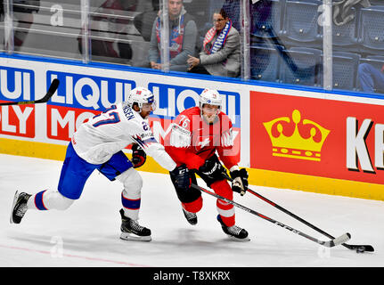 L-R Andreas Martinsen (NOR) and Joel Genazzi (CH) in action during the match between Switzerland and Norway within the 2019 IIHF World Championship in Bratislava, Slovakia, on May 15, 2019. (CTK Photo/Vit Simanek) - Stock Image