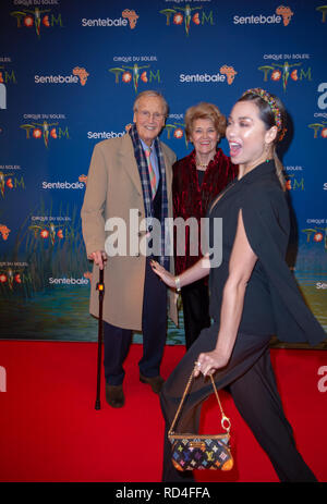 London, United Kingdom. 16 January 2019. Katya Jones photobombs Nicholas Parsons as he arrives for the red carpet premiere of Cirque Du Soleil's 'Totem' held at The Royal Albert Hall. Credit: Peter Manning/Alamy Live News - Stock Image