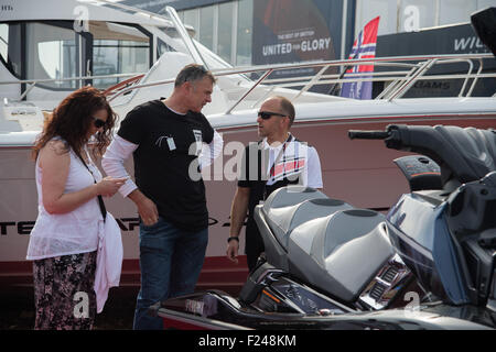 Southampton, UK. 11th September 2015. Southampton Boat Show 2015. Visitors speak to an exhibitor selling jet bikes. - Stock Image