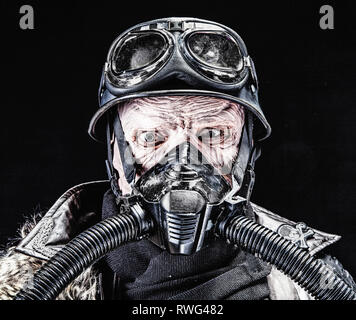 Ugly burnt face of futuristic Nazi soldier wearing gas mask. - Stock Image