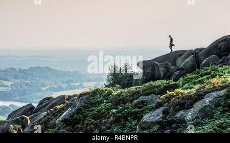 Man standing high up on rocks at the popular destination of The Roaches in North Staffordshire nr the market town of  Leek ,England UK. - Stock Image