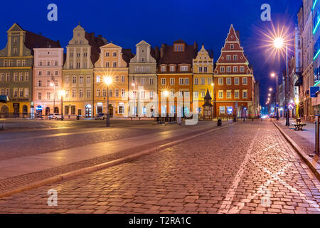 Colorful tenements on Market Square during morning blue hour in the Old Town of Wroclaw, Poland - Stock Image