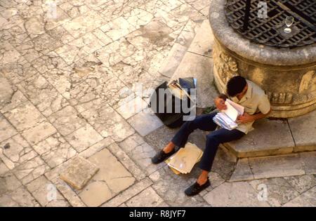 Postman sorting mail, Zadar, Croatia - Stock Image