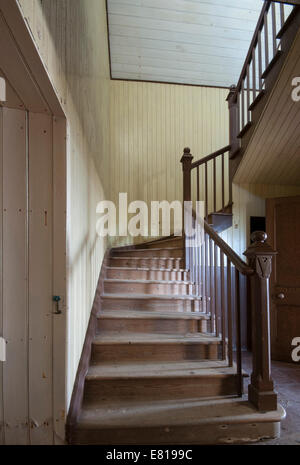 Old wooden staircase in a decommissioned church - Stock Image
