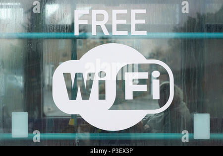 Sign for Free Wi Fi on glass window public transport bus, Suffolk, England, UK - Stock Image