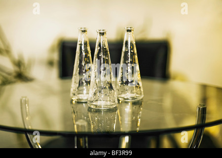 Three vases on a table - Stock Image