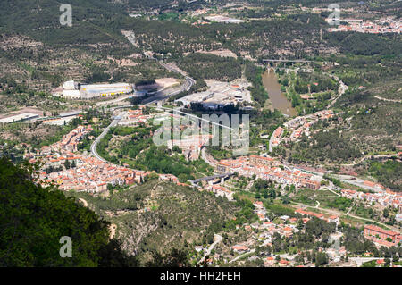 Town of Monistrol de Montserrat seen from above, with bridges over Llobregat river. Province of Barcelona, Catalonia, - Stock Image