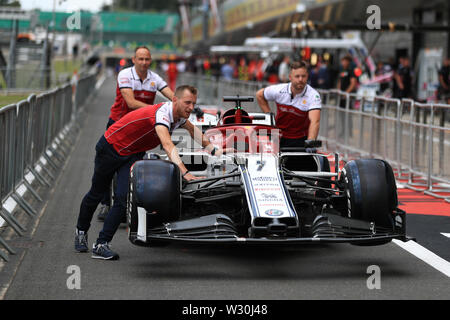 Silverstone, Northampton, UK. 11th July 2019. F1 Grand Prix of Great Britain, Driver arrivals day; Alfa Romeo Racing car gets pushed to the FIA garage for checks Credit: Action Plus Sports Images/Alamy Live News - Stock Image
