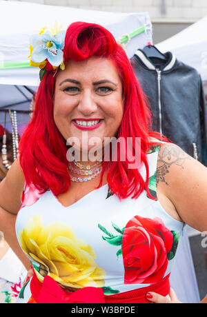 Poole, Dorset, UK. 14th July 2019. Poole Goes Vintage Event takes place on the Quay for a day of vintage music, dance, fashion, memorabilia, entertainment, vehicles and stalls on a 1940's and 1950's theme, including Lindy Hop and Jive on Poole Quay. Thousands turn out to watch, listen and take part. Credit: Carolyn Jenkins/Alamy Live News - Stock Image