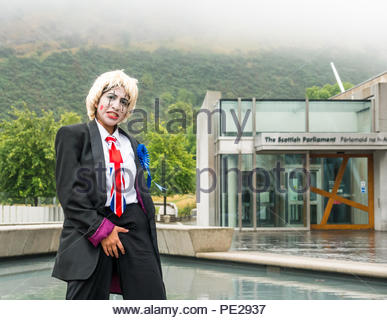 Edinburgh, Scotland, UK. 12th August 2018. Edinburgh Fringe Festival Photocall on a dreary Scottish weather day, Scottish Parliament, Holyrood, Edinburgh, Scotland, United Kingdom. Political clowns in silly poses outside the parliament. Pig Circus is billed as a 'Verbatim Brexit parody' about the government's handling of Brexit negotiations, with character Boris Johnson standing in front of the Scottish Parliament building. Produced by theatre group Hitchhiker Collective - Stock Image