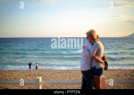 Lovers and kids on the beach Cannes, Alpes Maritimes, 06, PACA, France - Stock Image