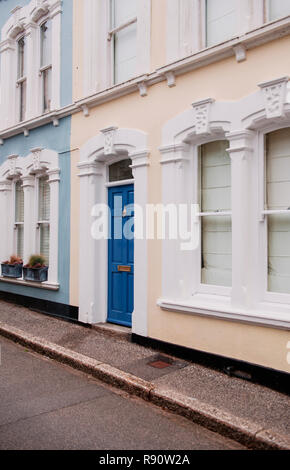 Row of terraced houses on a street in Fowey, Cornwall, England, UK - Stock Image