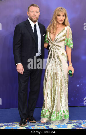 London, UK. 09th May, 2019. LONDON, UK. May 09, 2019: Director Guy Ritchie & wife Jacqui Ainsley at the 'Aladdin' premiere at the Odeon Luxe, Leicester Square, London. Picture: Steve Vas/Featureflash Credit: Paul Smith/Alamy Live News - Stock Image