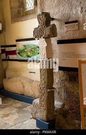 UK, Yorkshire, Wharfedale, Burnsall, St Wilfrid's 12th century church C9th or C10th Borrre style cross - Stock Image