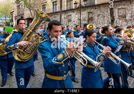 A marching band on a street in Seville, Spain - Stock Image