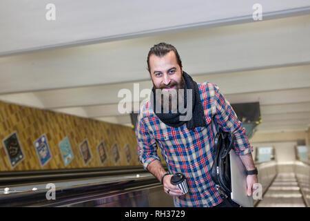 Portrait of mature man on escalator - Stock Image