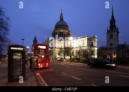 Three icons in one photo: St. Paul's, London Telephone and the Routemaster Bus. - Stock Image