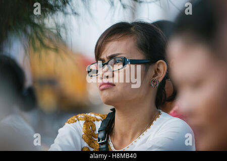 A Woman waiting for time to pray in Gianyar Bali - Stock Image