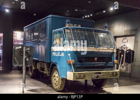 Police lorry with image of Lech Walesa in handcuffs,  European Solidarity Centre museum, Plac Solidarności, Gdańsk, Poland - Stock Image