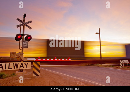 Train crossing at Pimba South Australia - Stock Image