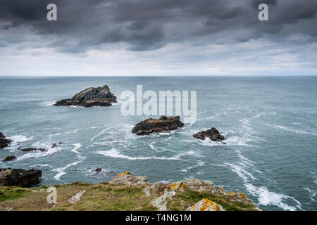 Goose Island and two smaller rocky islands off Pentire Point East in Newquay in Cornwall. - Stock Image