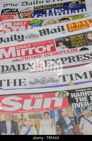 Pile of English Newspapers from the United Kingdom - Stock Image