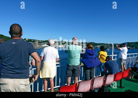 Capturing photographs of Oban as visitors arrive in the port on the Calmac ferry from the Isle of Mull - Stock Image