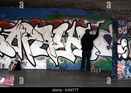 Graffiti artist at the South Bank London - Stock Image