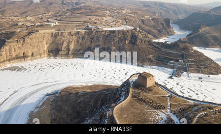 Hohhot. 17th Feb, 2019. Aerial photo taken on Feb. 17, 2019 shows snow scenery at the Laoniuwan section of the Yellow River at the border area between north China's Shanxi Province and Inner Mongolia Autonomous Region. Credit: Peng Yuan/Xinhua/Alamy Live News - Stock Image