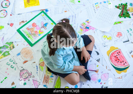 Five years student over her whole year homework. Homework overload for kids concept - Stock Image