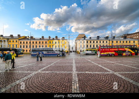 Tour busses line up at the Senate Square in Helsinki Finland with the  restored Sofiankatu Street in view. - Stock Image