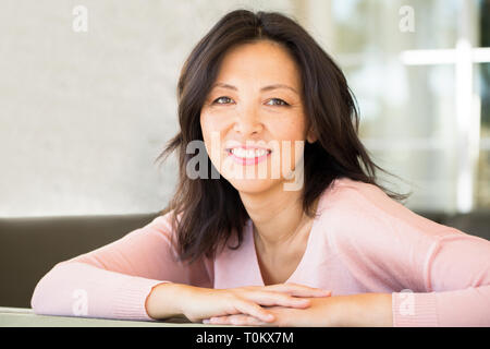 Portrait of an Asian woman smiling. - Stock Image