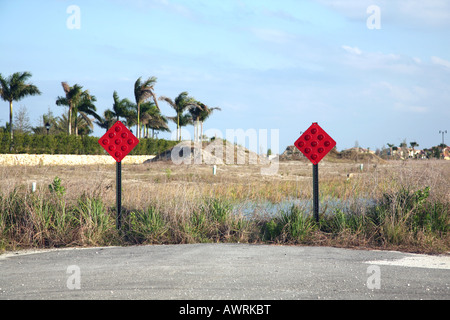 Two red warning sign indicating the end of a road - Stock Image