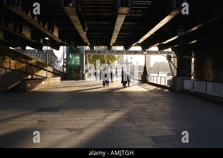 Underneath the Hungerford Bridge South Bank London - Stock Image