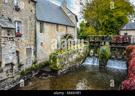 The water mill on the River Aure in the medieval town of Bayeux on the Normandy Coast of France, with early autumn - Stock Image