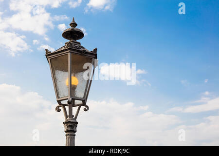 Detail of german streetlamp with sky in background and copyspace. - Stock Image