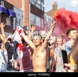 Brentwood, UK. 7th June 2018.Over a thousand (police estimate) celebrating England fans blocked Brentwood High Street, letting off smoke bombs and chanting for about half an hour.  The crowd was mostly good natured and happy at the England victory Credit Ian Davidson/Alamy Live News - Stock Image