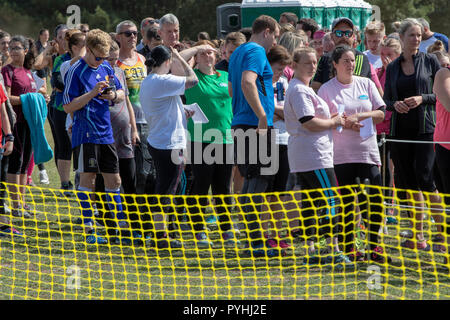 Runners assembling at the start of a cross country obstacle course run - Stock Image