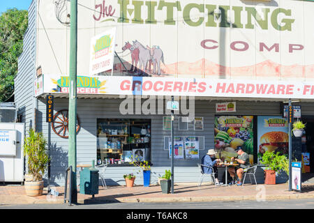 Couple having lunch at the terrace of an old groceries stores in Surat, Maranoa Region, Queensland, QLD, Australia - Stock Image