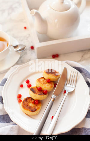 Syrniki with cranberries - Stock Image