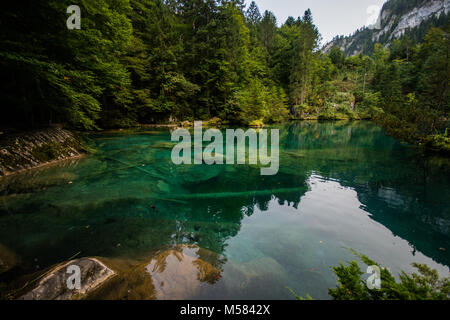 Lake Blausee in the beautiful country of Switzerland in the Swiss alps in kandergrund, Europe whilst traveling on - Stock Image