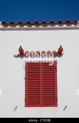 Portugal, Algarve, Carvoeiro, Shuttered Window - Stock Image