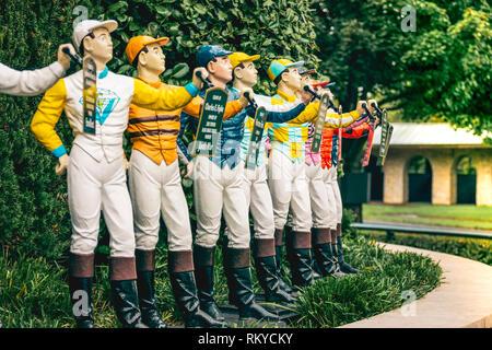 Jockey statues painted in the winning colors seen in the paddock of Keeneland Racetrack in Lexington in Kentucky. - Stock Image