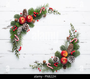 Fir tree branch with cones,apples and berries - Stock Image