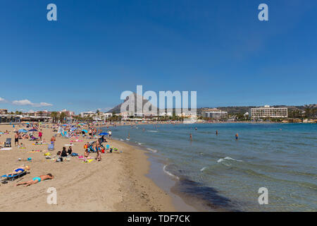 Spanish beach Xabia Spain Playa del Arenal in summer with blue sky and people, also known as Javea - Stock Image