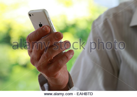 Close shot of man hand holding an iphone. - Stock Image