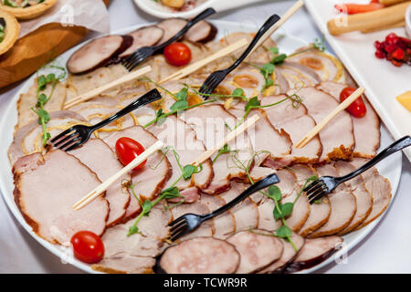 Beautifully decorated appetizers for the catering banquet table.Catering for events snacks for buffet - Stock Image